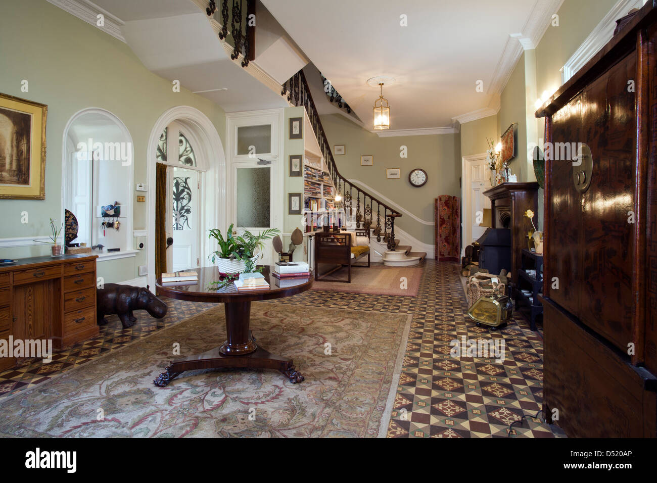 A large period entrance hall and stairs. - Stock Image