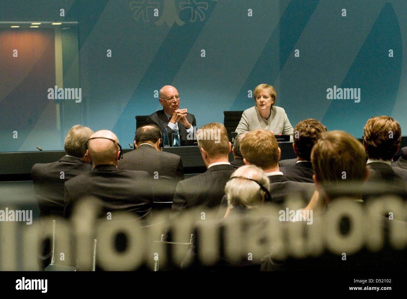 German Chancellor Angela Merkel and President of the World Economic Forum (WEF), KLaus Schwab, meet with members - Stock Image