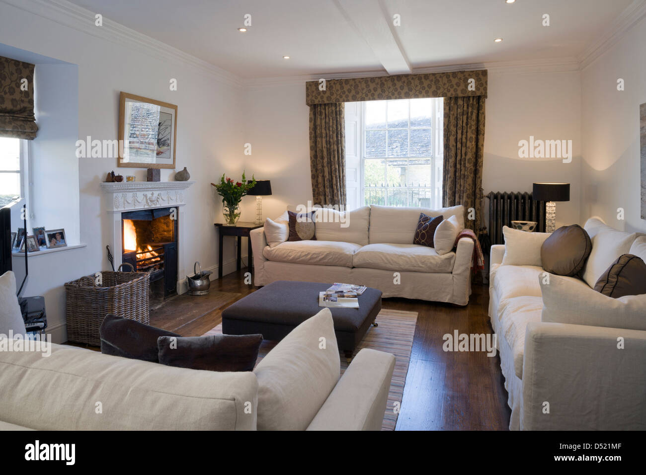 A large contemporary sitting room with three sofas Stock Photo ...