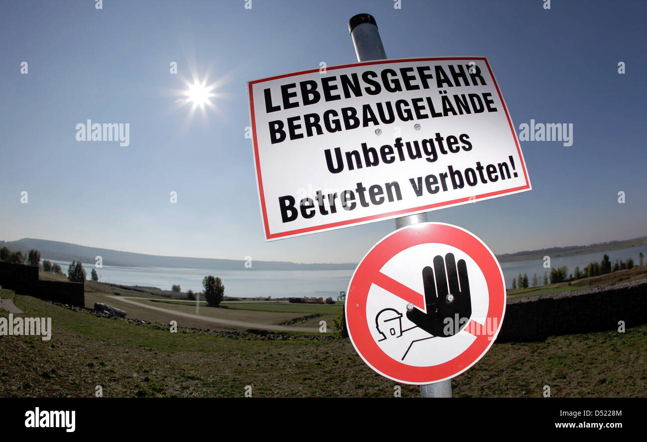 a sign warns of mortal danger for trespassers of the lake s bank at