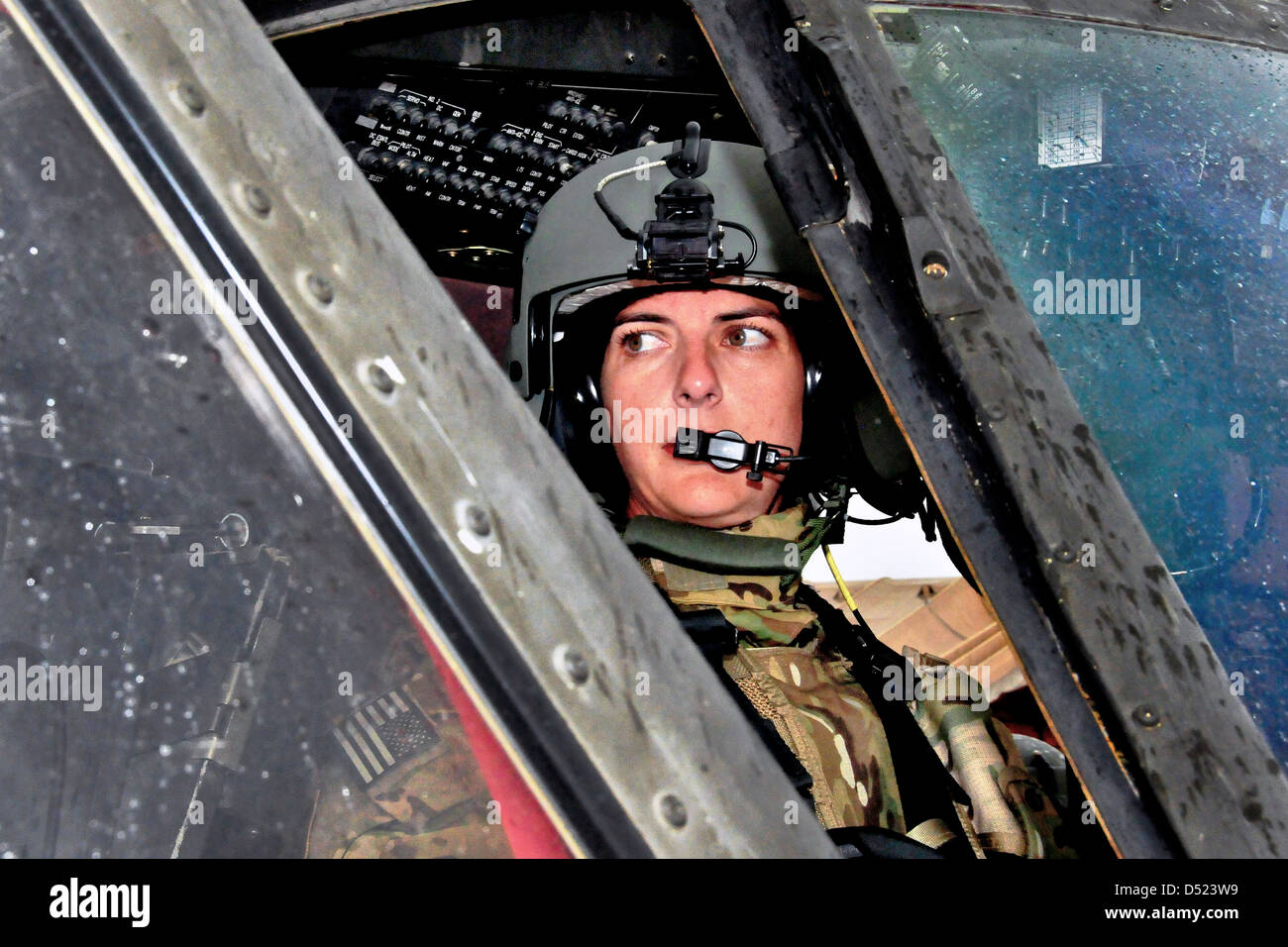 US Army Chief Warrant Officer Bethany Bump conducts her pre-flight check in a UH-60 Black Hawk helicopter before Stock Photo