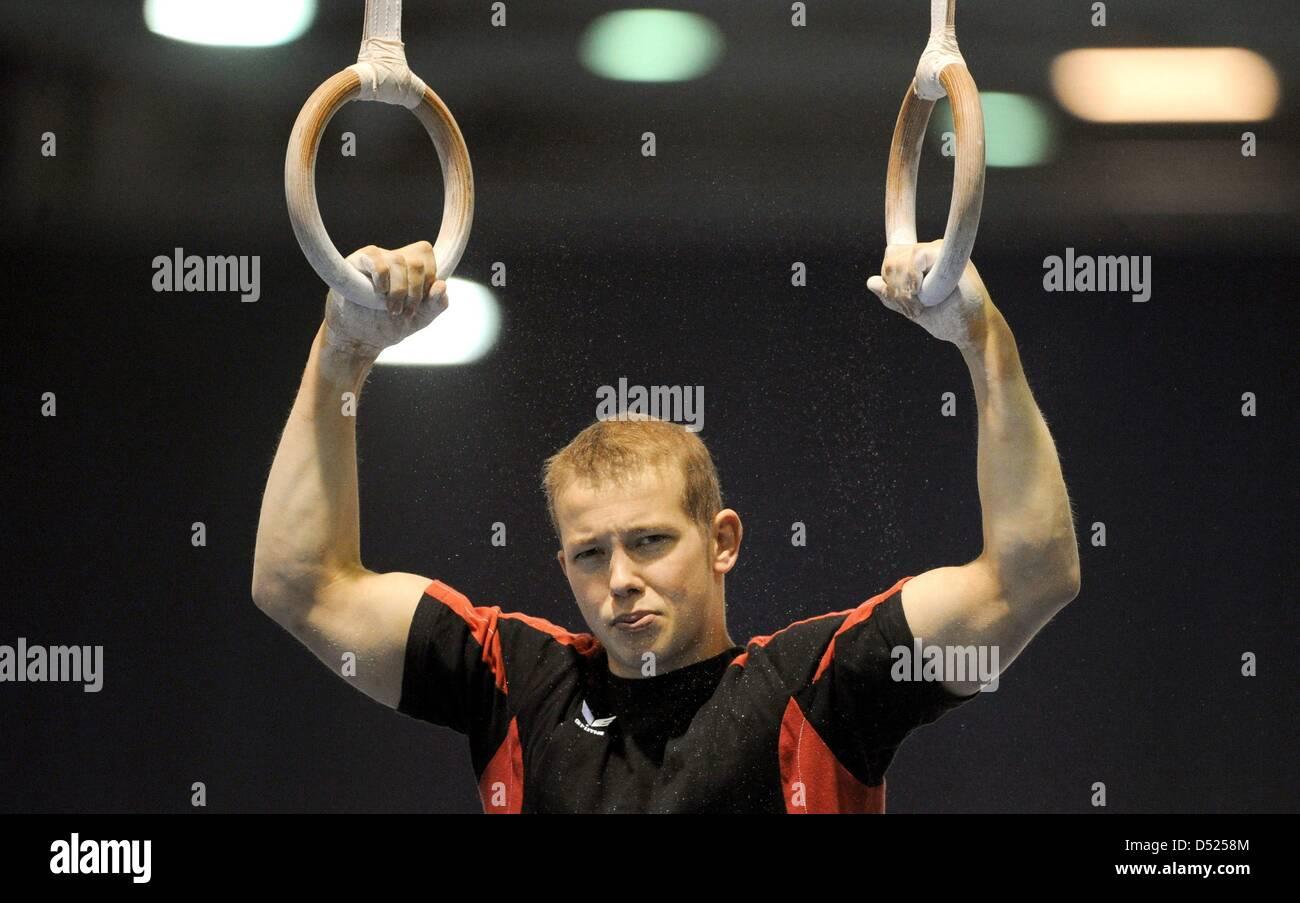 German gymnast Fabian Hambuechen warms up at the 2010 Artistic Gymnastics World Championships in Rotterdam, The Stock Photo