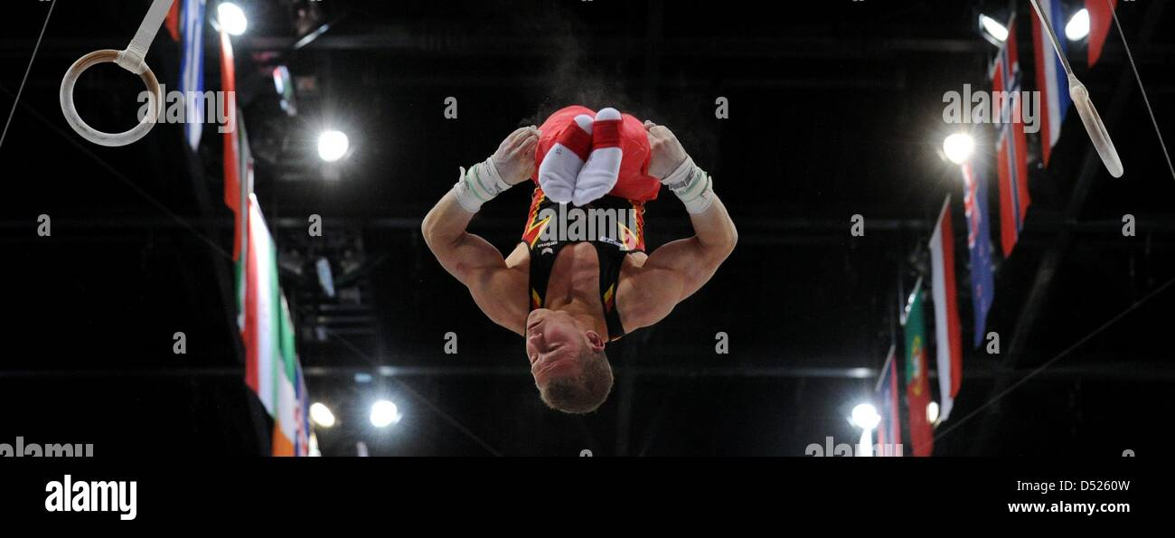 German Fabian Hambuechen performs on the rings during the qualification at the Artistic Gymnastics World Championships - Stock Image
