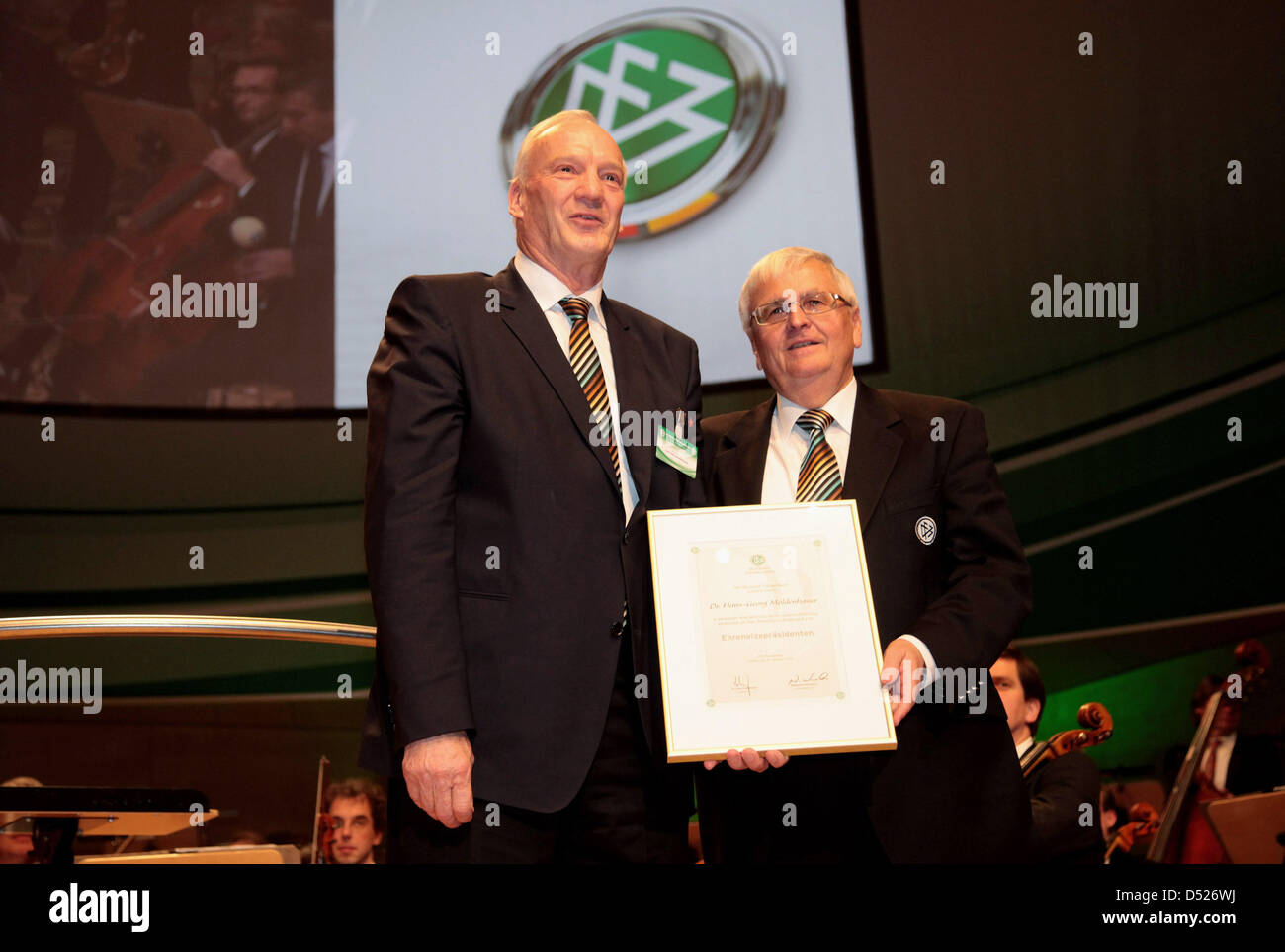 DFB-Vice-President Hans-Georg Moldenhauer (L) is honored by Theo Zwanziger, president of the German Football Association - Stock Image