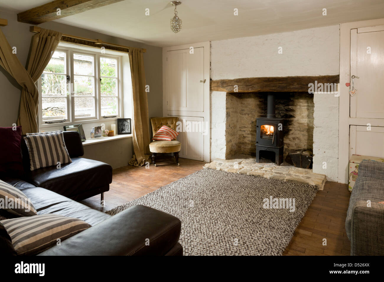 A small cottage living room with period features and for Small cabin living room ideas