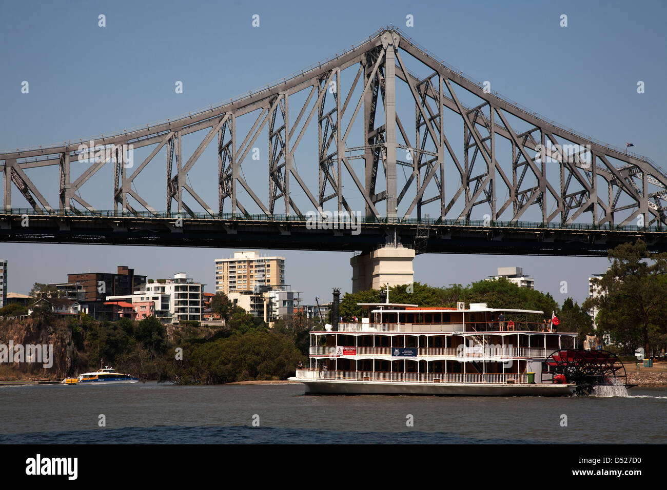 Tourist Paddle Boat on the Brisbane River passing under the Storey Brisbane Queensland Australia - Stock Image