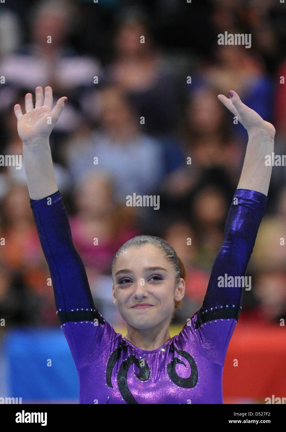 Gymnasts Alija Mustafina from Russia cheers during the award ceremony of the women's All-round-finale of the - Stock Image