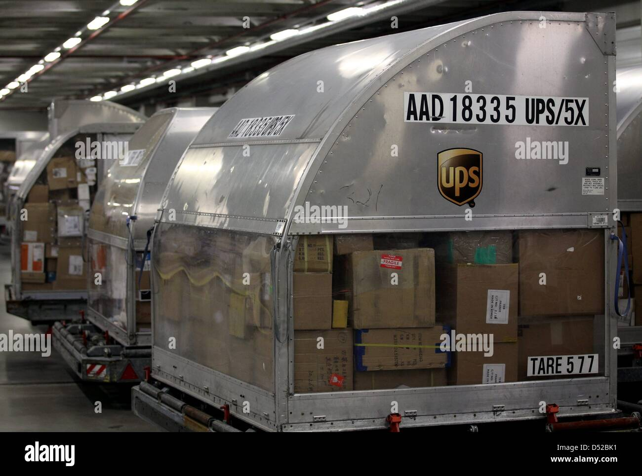 Packages of UPS lie at the cargo centre of Cologne-Bonn airport in Cologne, Germany, 1 November 2010. German Minister - Stock Image