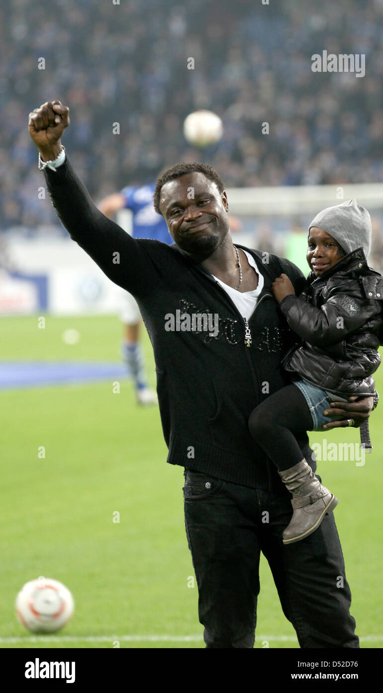 Former Schalke player Gerald Asamoah, accompanied by his children, says good-by to the fans of soccer club FC Schalke - Stock Image
