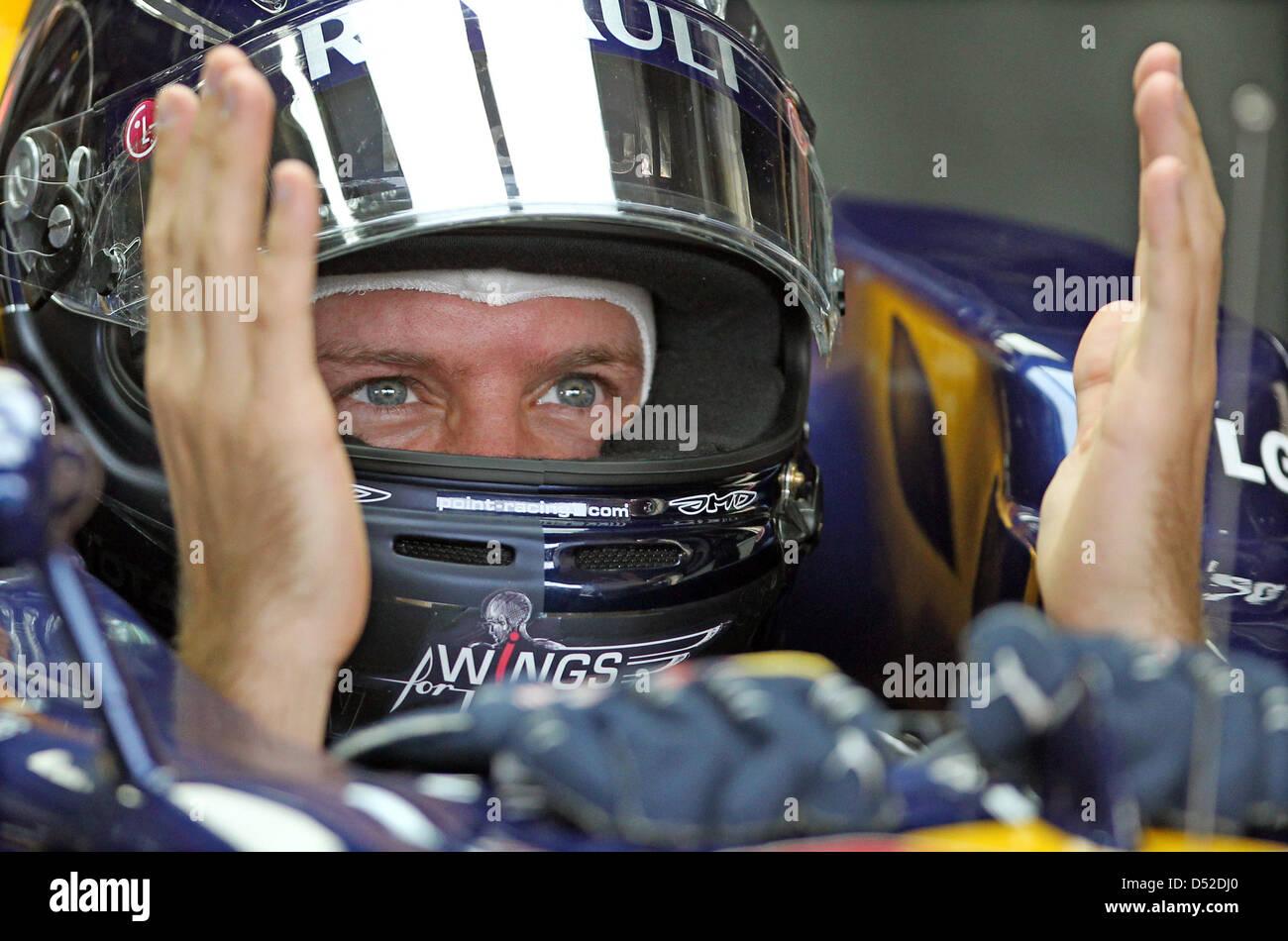 German Driver Sebastian Vettel Of Red Bull Jokes With His Mechanics