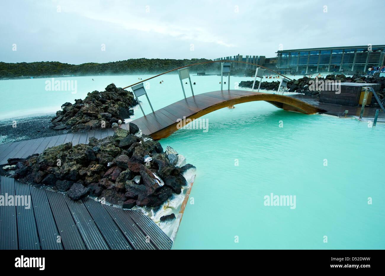Wooden bridge in the Blue Lagoon geothermal bath resort in Iceland ...