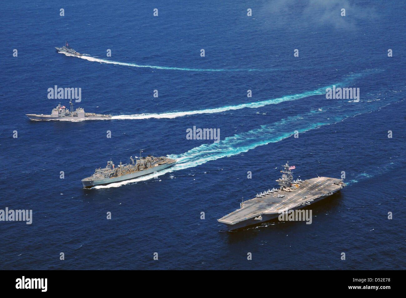 US Navy guided-missile cruiser USS Bunker Hill, Military Sealift Command fast combat support ship USNS Rainier and - Stock Image