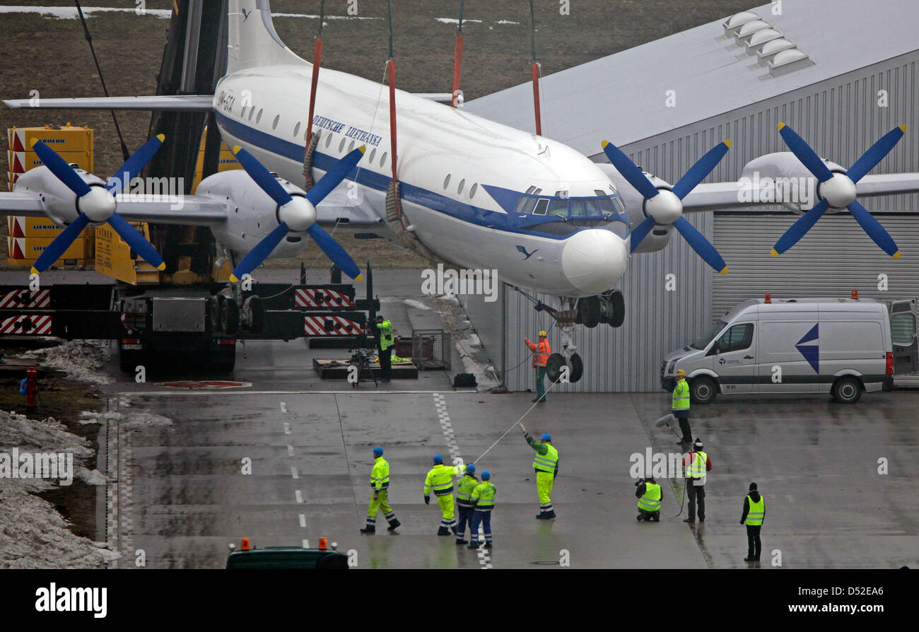 Staff members help bringing an Ilyushin IL 18 airplane to the ground at the airport Leipzig/Halle in Schkeuditz, Stock Photo