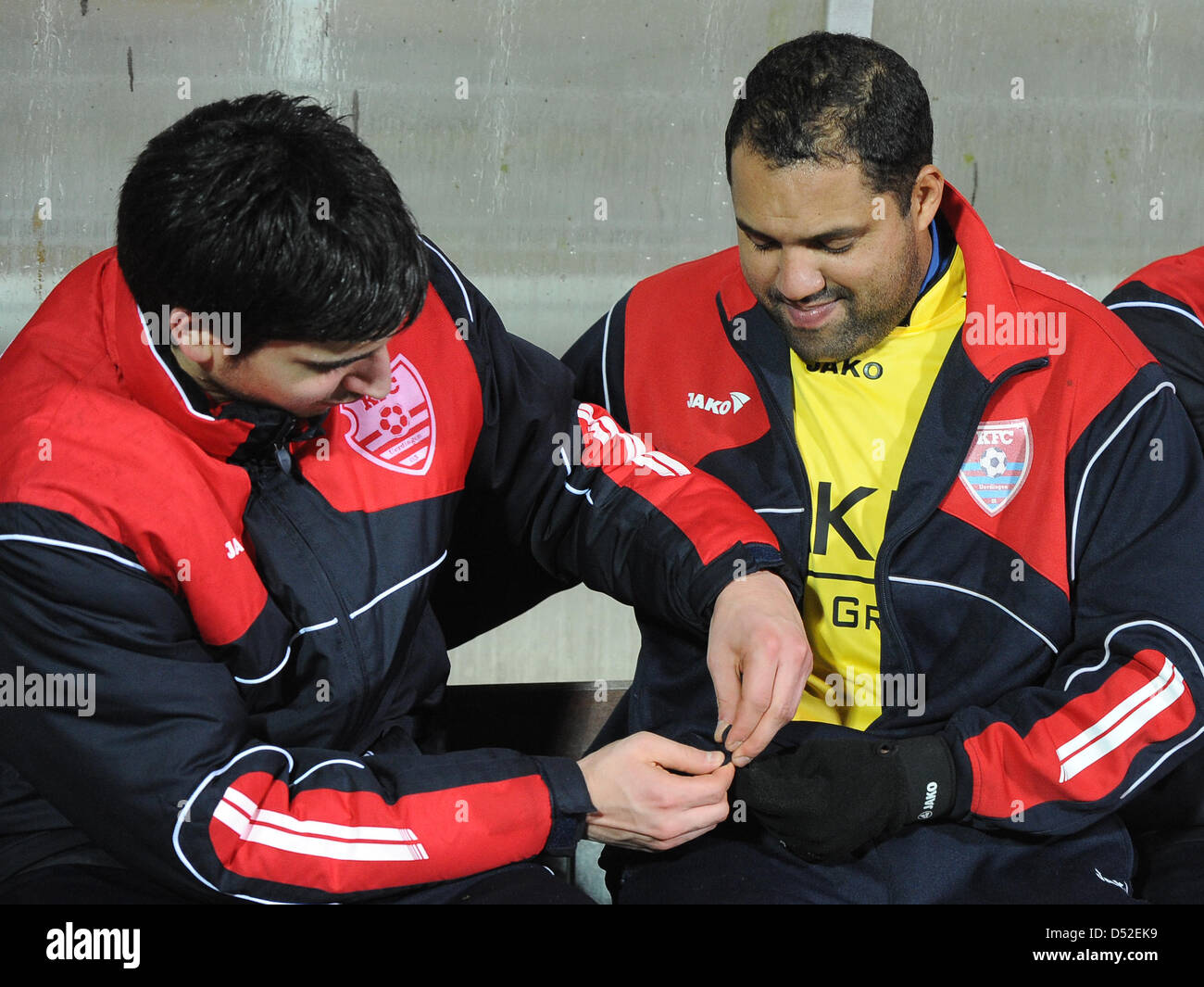 Former Bundesliga topscorer Ailton (L) sits on the bench of KFC Uerdingen at the 'Grotenburg Kampfbahn' in Krefeld, Stock Photo