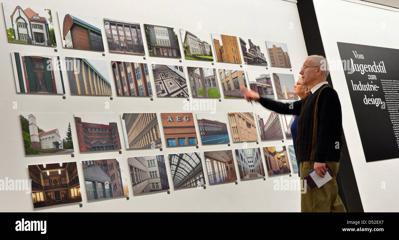 Visitors view photos of houses designed by Behrens at the exhibition 'From Art Nouveau to Industrial Design', - Stock Image