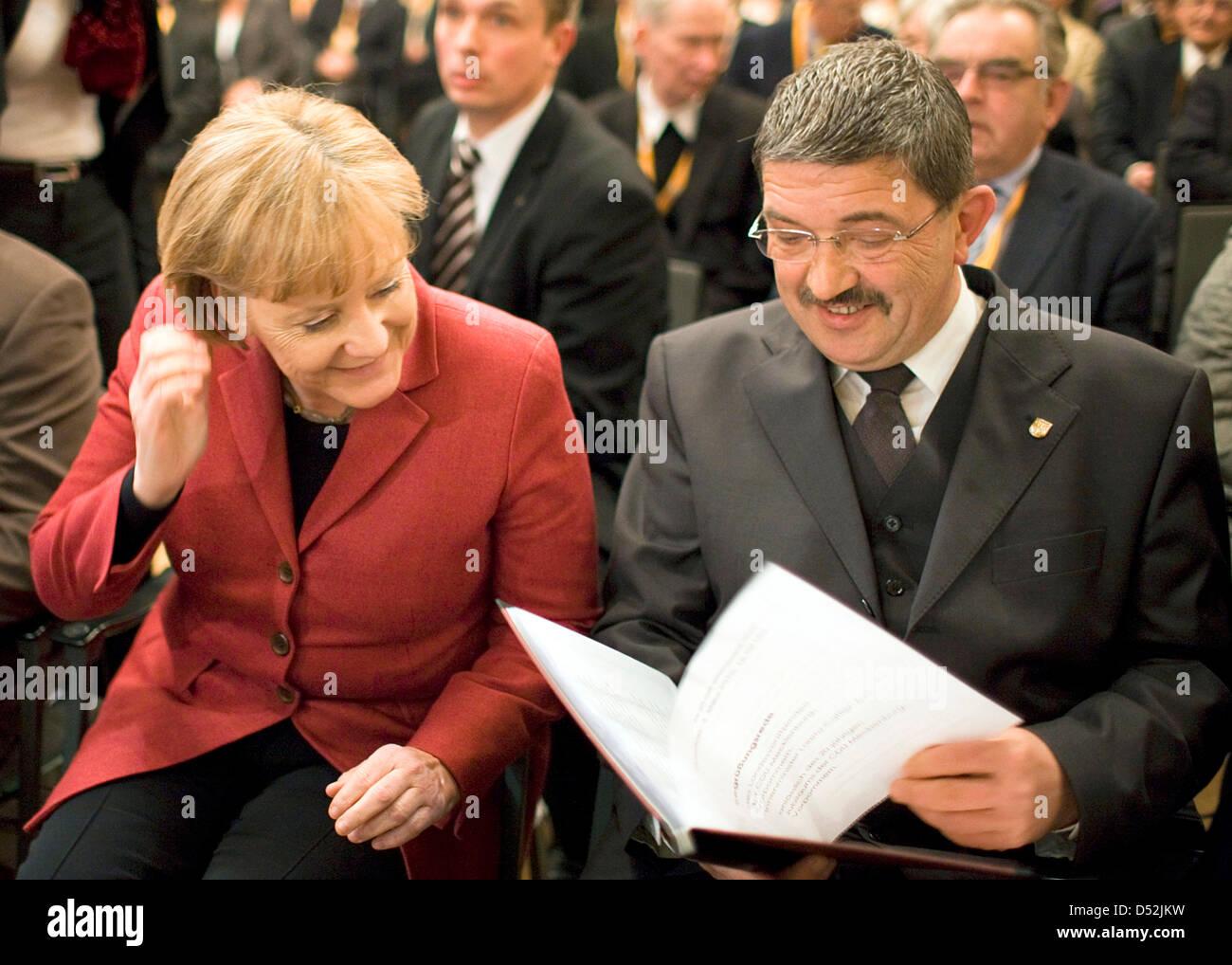 German Chancellor Angela Merkel and CDU (Christian Democratic Union) state boos Lorenz Caffier ahead of the festive - Stock Image