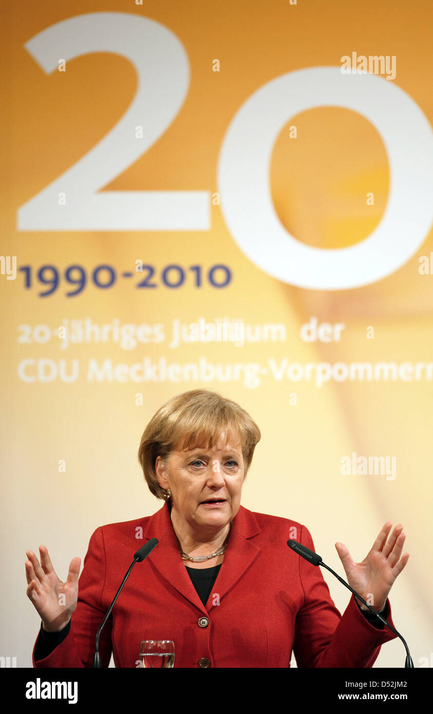 German Chancellor Angela Merkel gives a speech during the festive anniversary event in Schwerin, Germany, 03 March - Stock Image