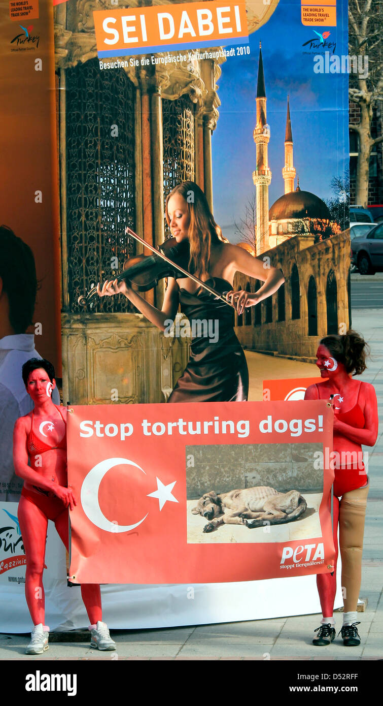 Members of the animal rights organisation PETA demonstrate in front of the International Travel Trade Show ITB in - Stock Image