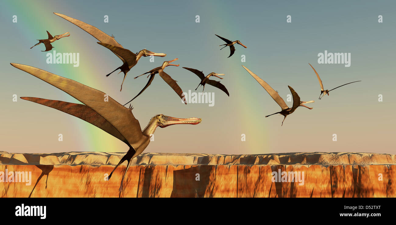 A flock of Pterodactyls fly out of a canyon looking for new prey to eat. - Stock Image