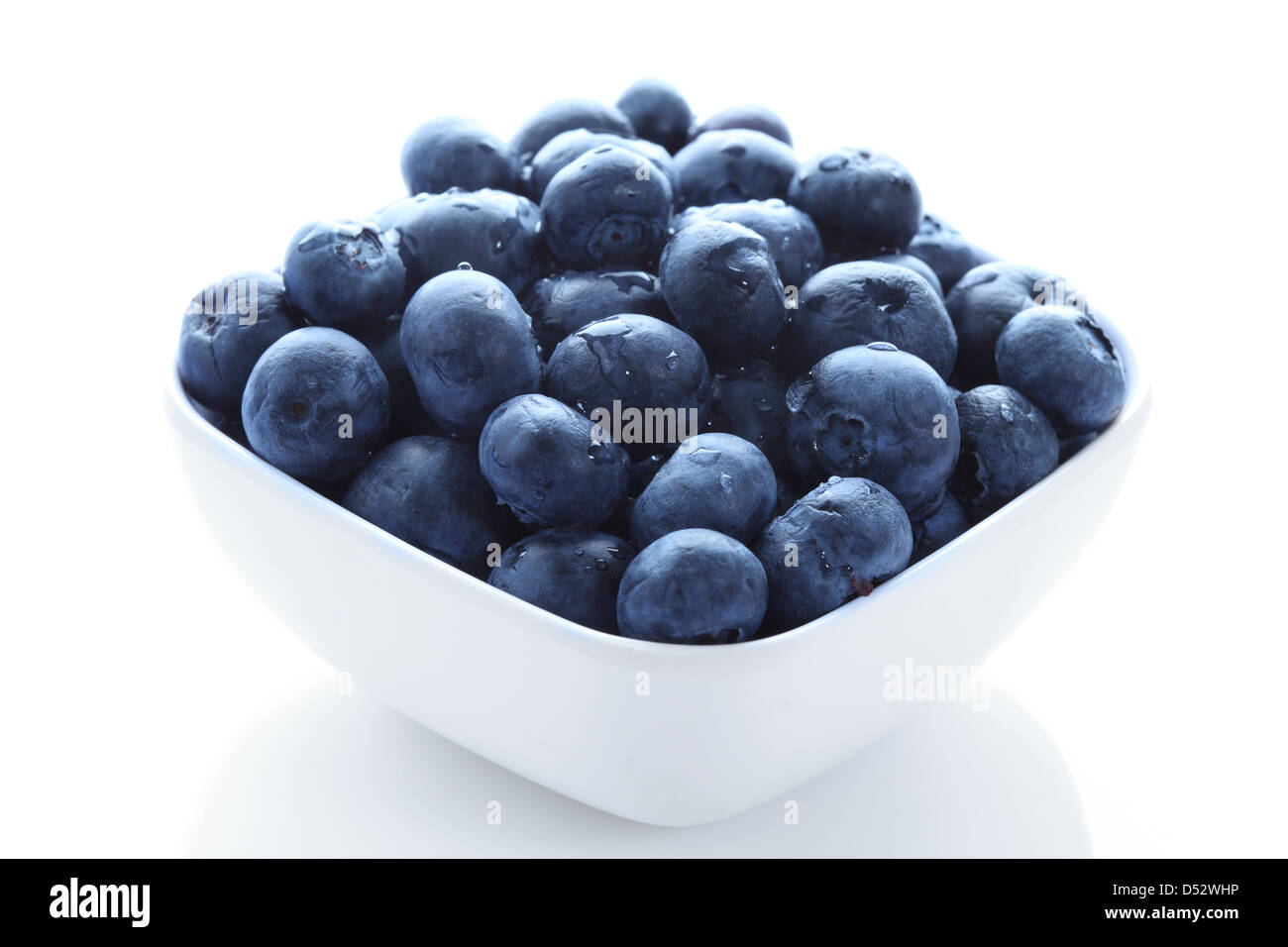 Organic blueberries in high resolution in a white bowl - Stock Image