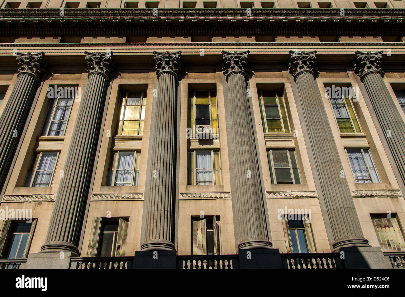 Roman style columns on a building in Montevideo - Stock Image