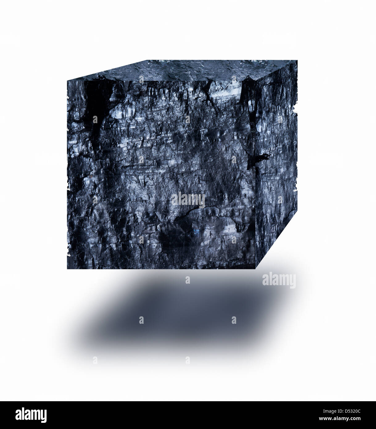 Graphite cube floating in air over white background - Stock Image