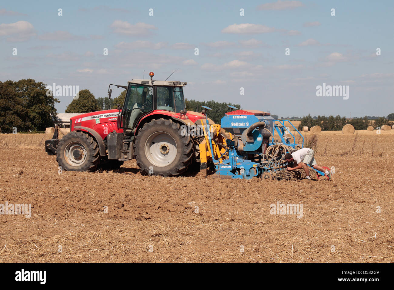A Massey Ferguson 7485 tractor being prepared in a field in northern France with a Lemken Solitair 9 pneumatic seed - Stock Image