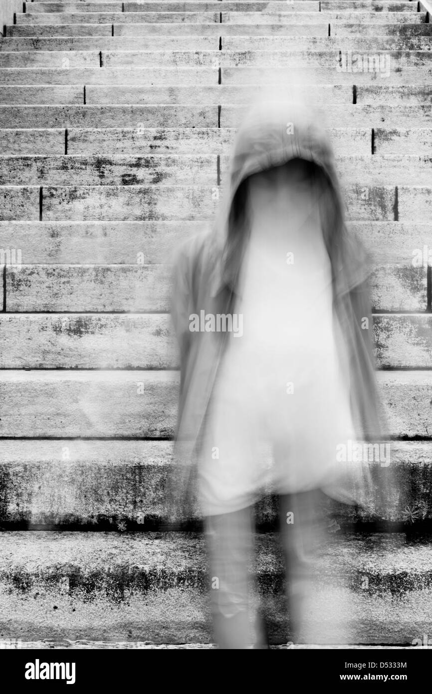 young girl running down on stairs - Stock Image
