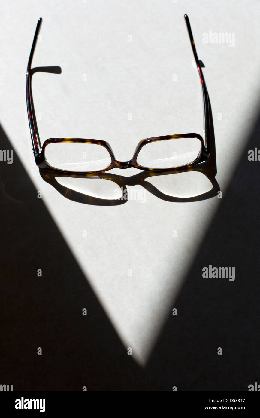 eye glasses casting shadow - Stock Image