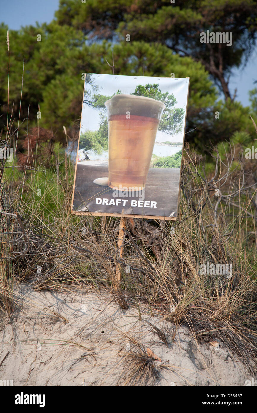 Vourvourou, Greece, a poster advertises for draft beer - Stock Image
