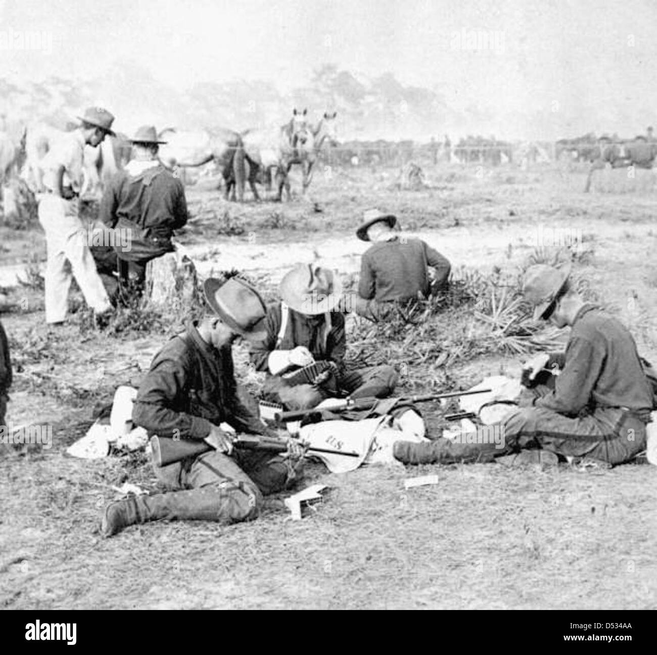 Rough Riders filling belts with cartridges - Stock Image