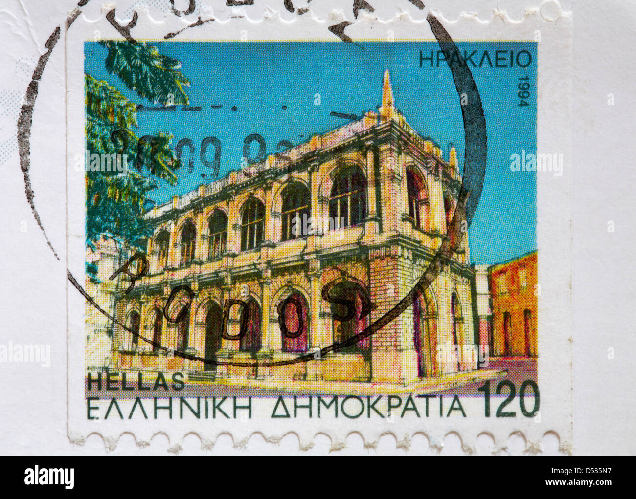 Greek stamp stuck on postcard Stock Photo