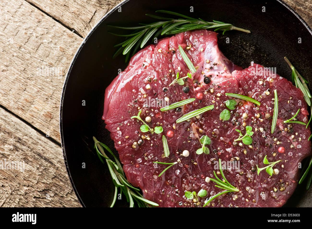 beef piece in frying pan - Stock Image