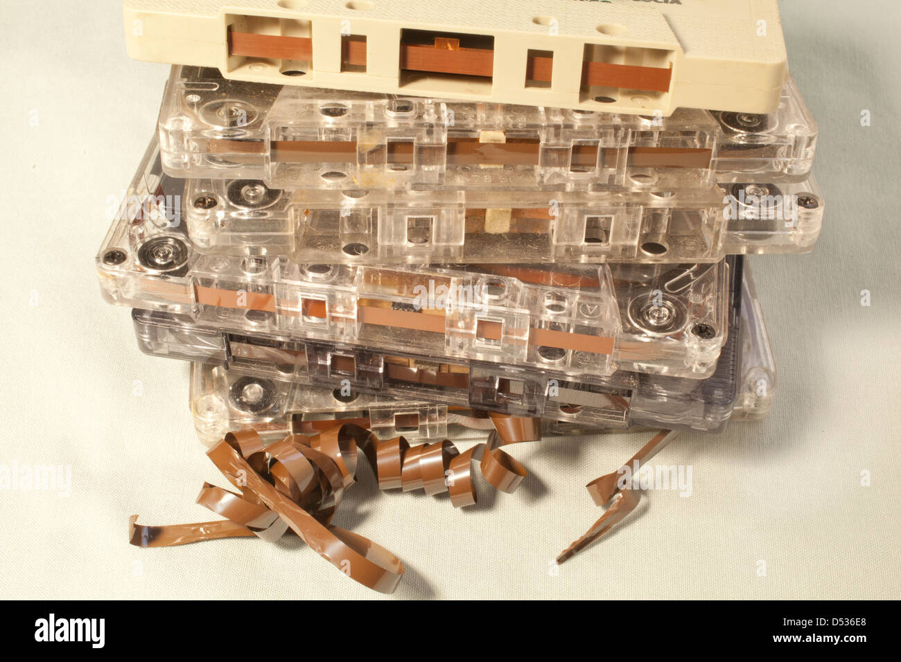 A pile of old cassette tapes. - Stock Image