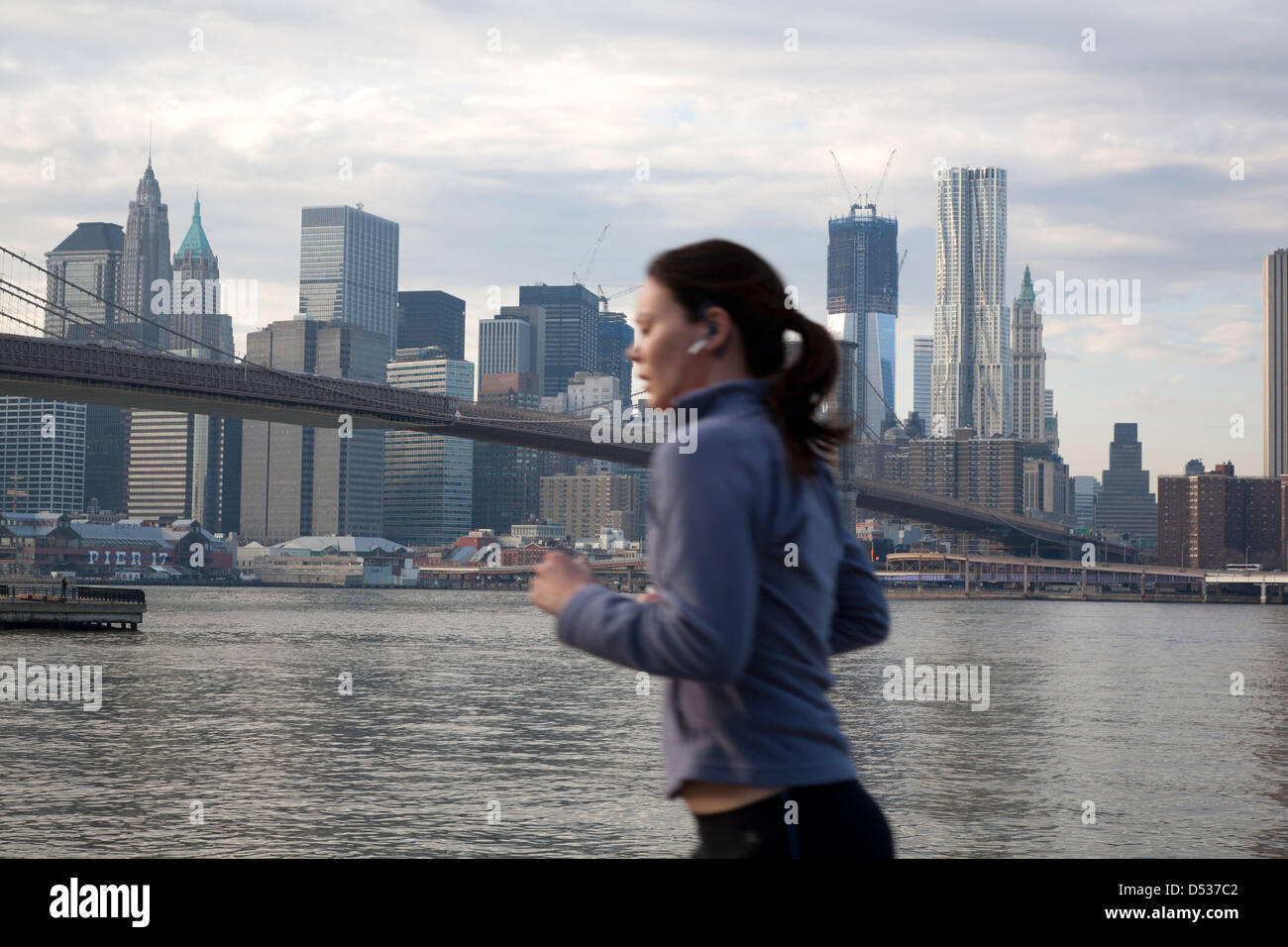 New York City Usa Female Jogger On The Banks Of The East River