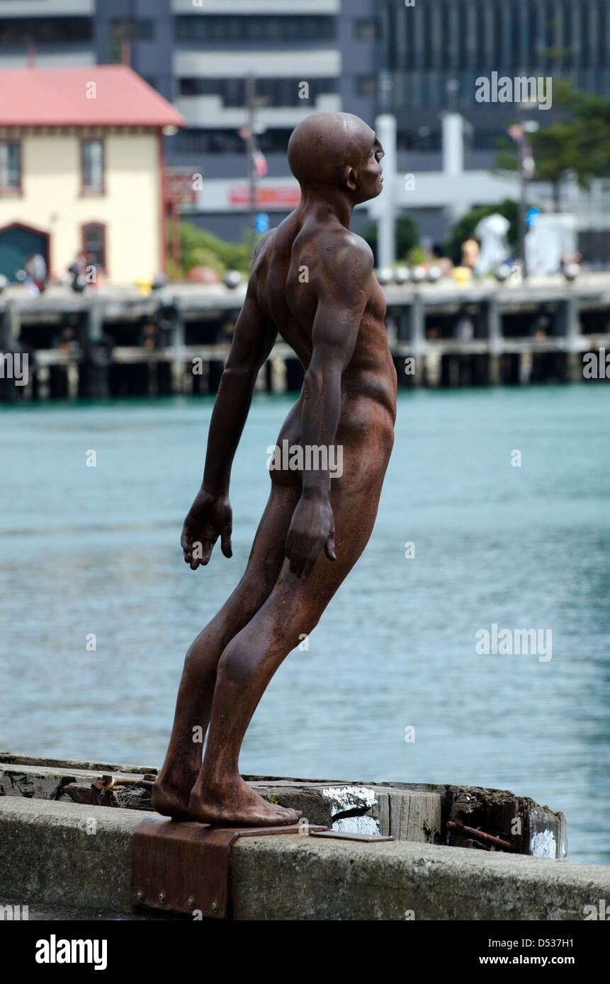 The famous Solace of the Wind statue which leans over the edge of the pier on the Wellington waterfront NZ - Stock Image