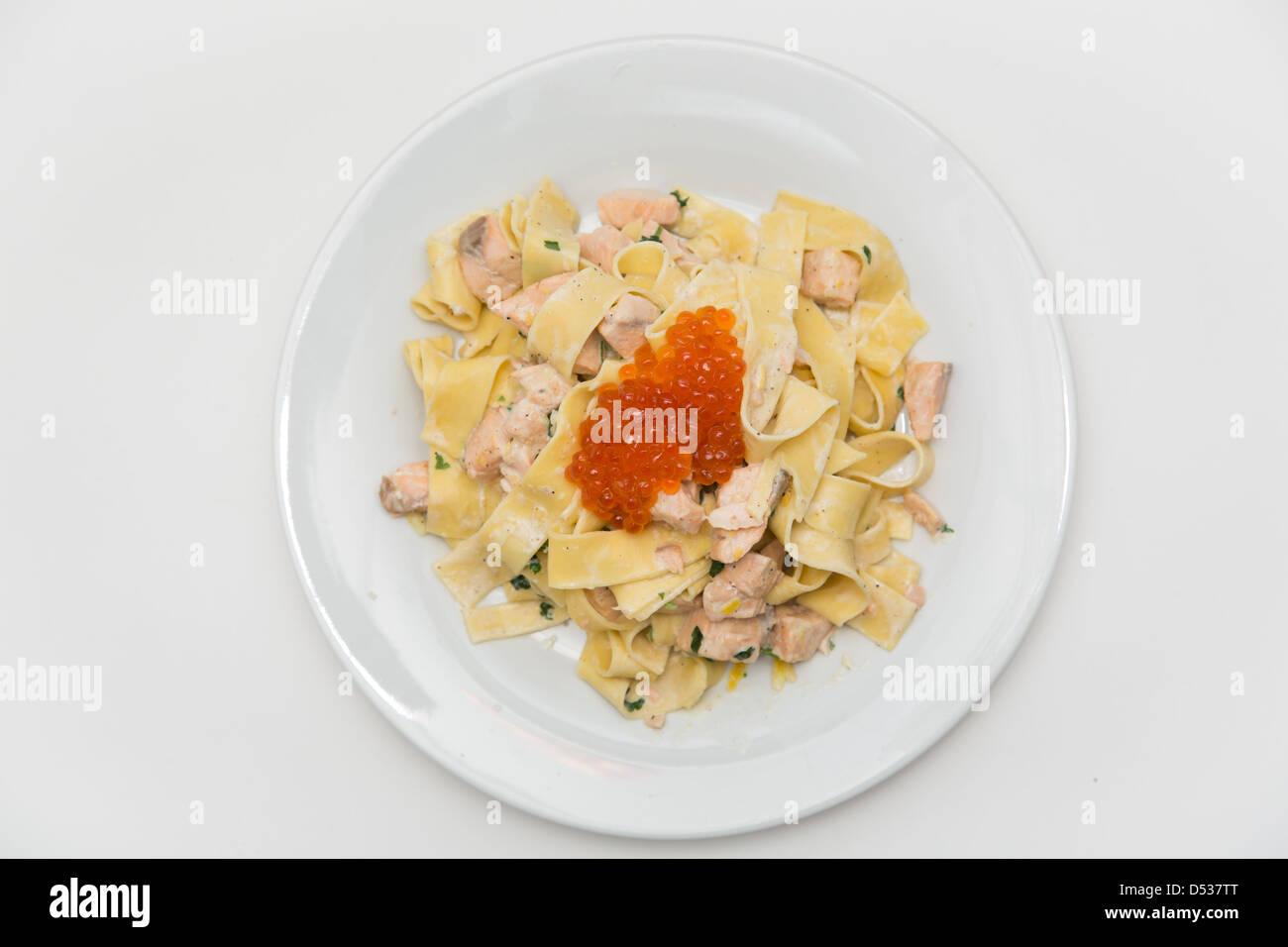 Pasta with caviar and salmon fish - Stock Image