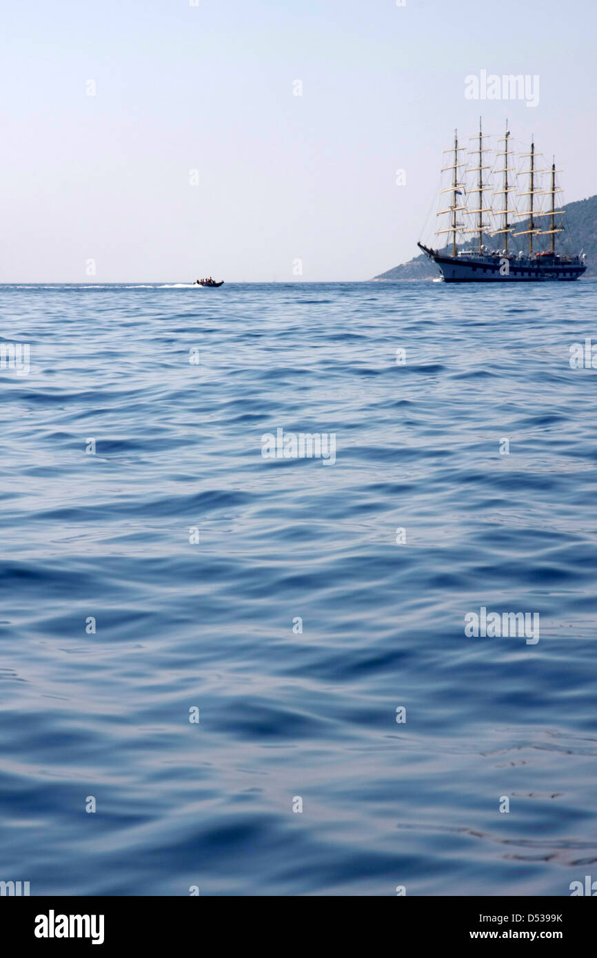 Big sailboat and small rubber boat Stock Photo: 54777567 - Alamy