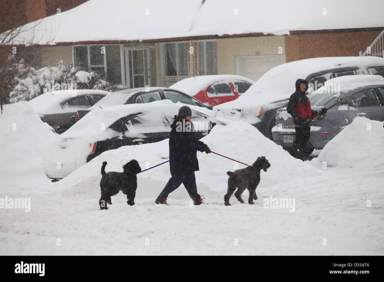 Snow clearing after a heavy snowstorm in Kitchener, Ontario, Canada ...