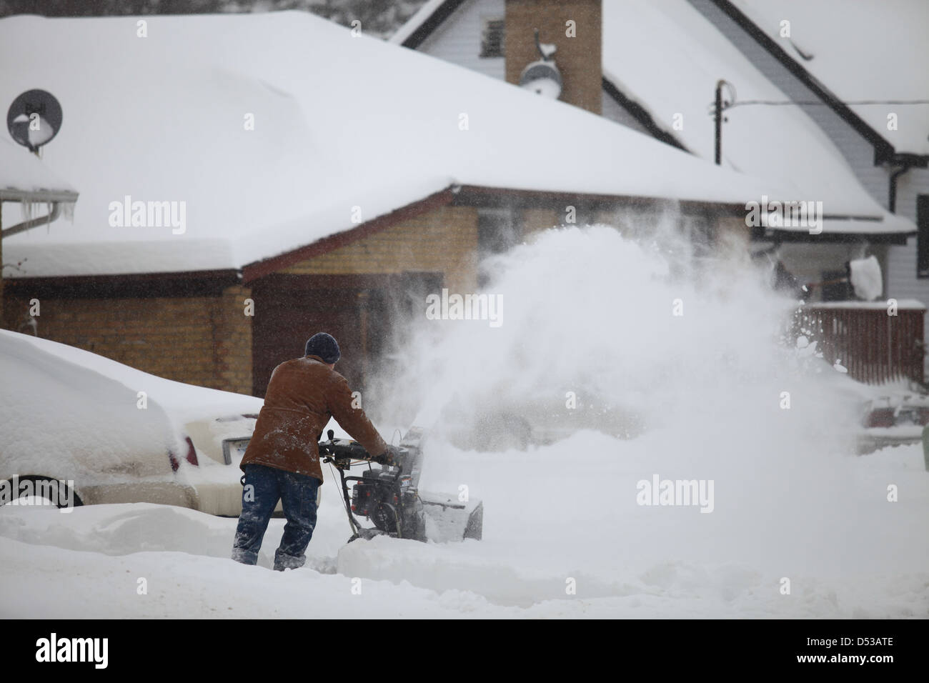 Man with snow blower after a heavy snowstorm in Kitchener, Ontario ...