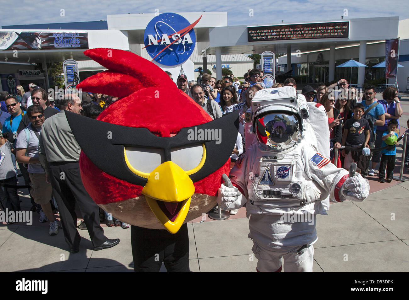 A character in an astronaut spacesuit and Red Bird, one of the Angry Bird characters, welcome visitors to the Angry - Stock Image