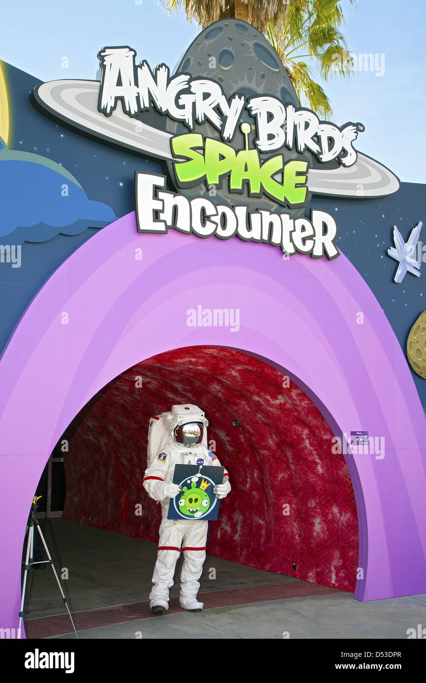 An astronaut stands at the entrance of the new Angry Birds Space Encounter during the grand opening ceremony at - Stock Image