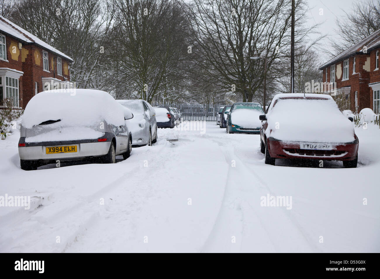 Rotherham, UK. 23rd March 2013. Snowbound. Residents of this Rotherham street face a long wait before the gritters - Stock Image