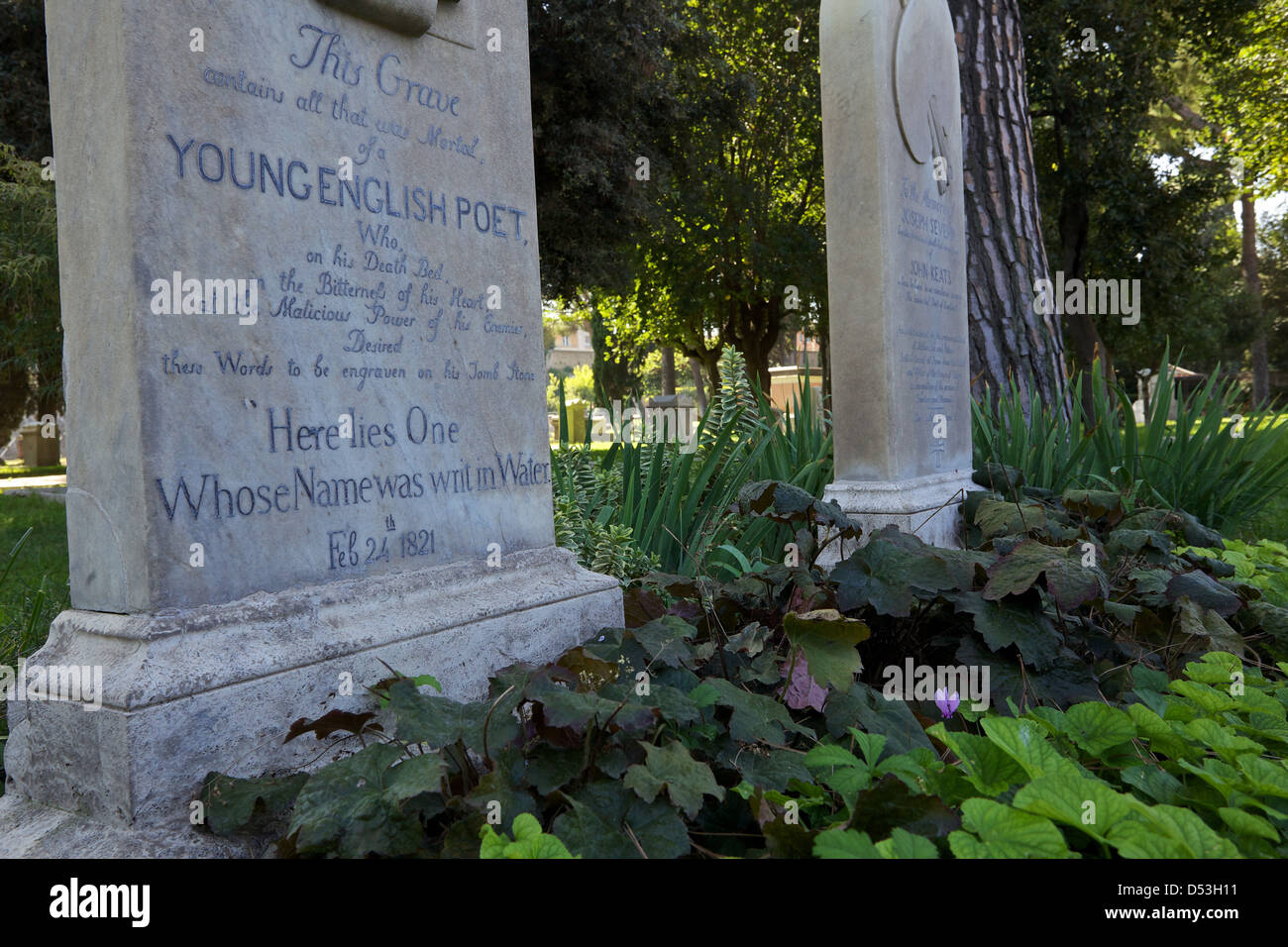 Gravestone of John Keats in the Protestant Cemetery of Rome.  'Here lies one whose name  was writ in water' - Stock Image
