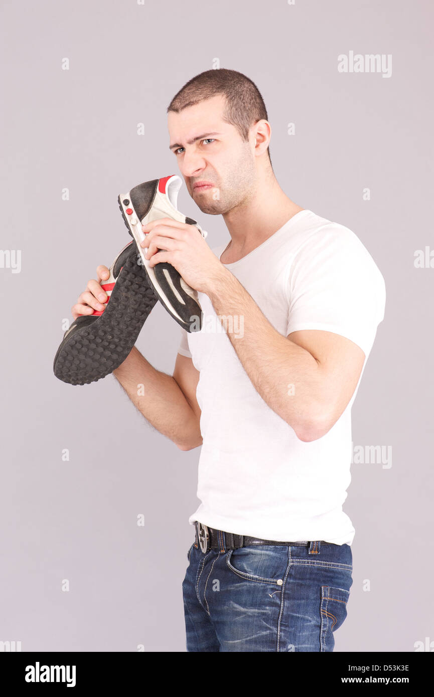 Man surprised Portrait looking at sweat stain perspiring and shoes - Stock Image