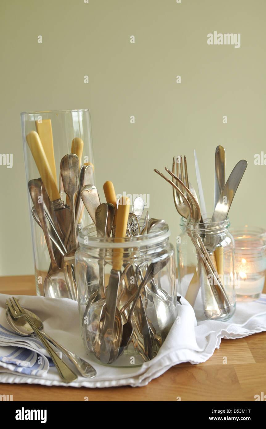 Three jars of vintage cutlery - Stock Image