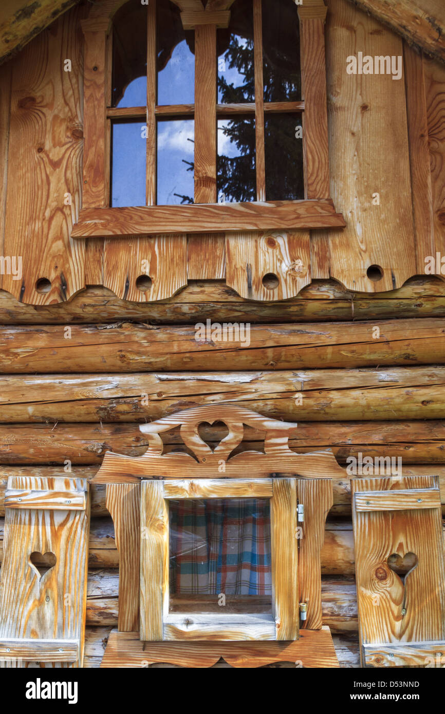 Wooden log cabin in the European Alps - Stock Image