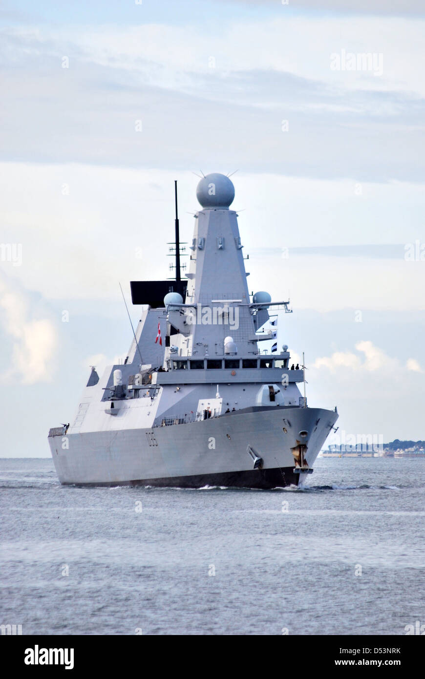 The Royal Navy Destroyer HMS Dragon arrives at Portsmouth following an exercise in the Solent. - Stock Image