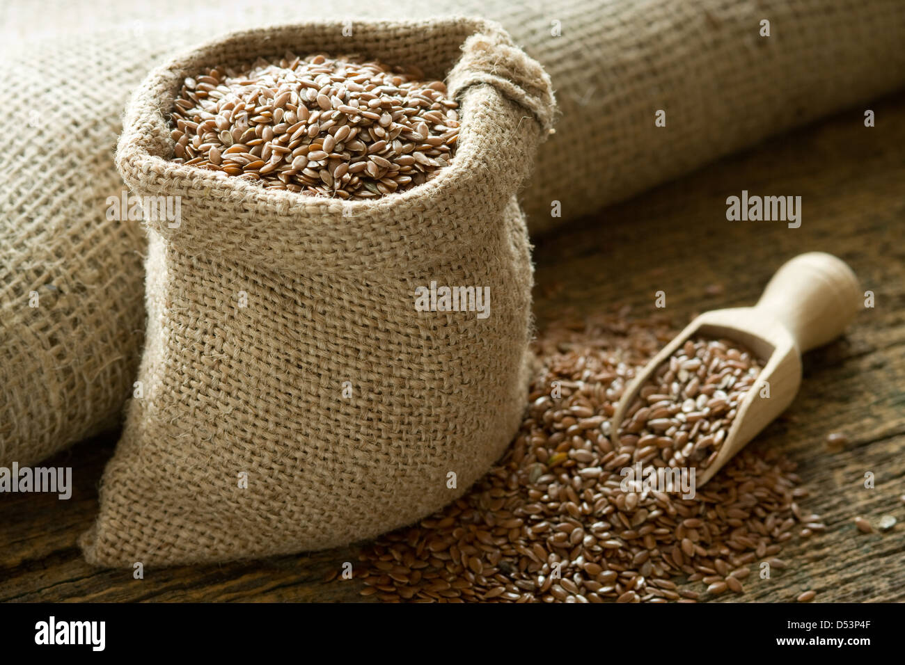 Flax seed in a burlap bag - Stock Image