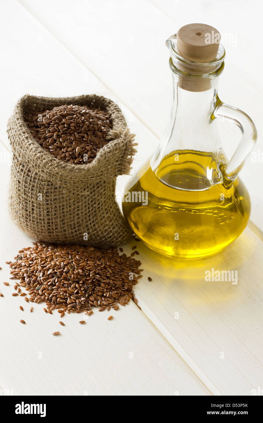 Linseed oil and flax seeds in small sack - Stock Image